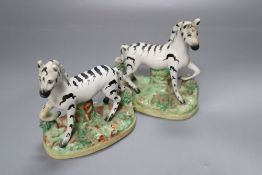 A pair of Victorian Staffordshire zebra, width 11cm