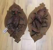 A pair of 19th century Black Forest carved walnut plaques depicting game birds