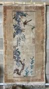 A Chinese ivory ground rug, 76 x 140cm