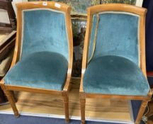 A pair of Biedermeier style birch tub chairs, height 85cm
