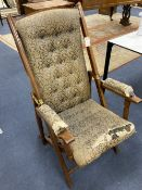 A late 19th / early 20th century mahogany folding campaign armchair