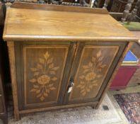 An Arts & Crafts stencilled oak and walnut side cabinet, width 92cm, depth 44cm, height 94cm
