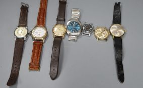 Seven assorted gentleman's wrist watches including Seiko and Timex.