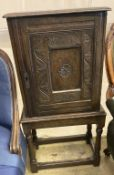 An 18th century design carved oak spice cabinet on associated stand (incorporates old timber), width