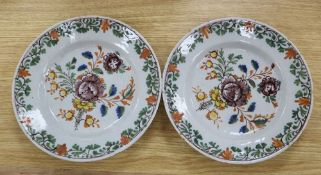 A pair of Delft tin-glazed earthenware plates, painted in polychrome enamels, c.1780, diameter
