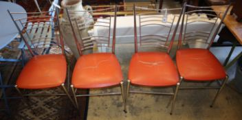 A set of four chrome and leatherette dining chairs