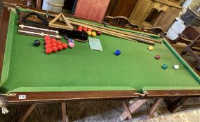 An early 20th century mahogany slate bed snooker table and accessories, width 194cm, depth 102cm