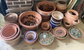 Approximately 25 assorted garden planters and dishes bases, mainly terracotta, largest diameter