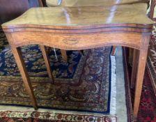 A George III inlaid satinwood folding-top serpentine card table, width 88cm, depth 45cm, height