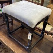 A 17th century oak stool with upholstered seat, width 55cm, depth 42cm, height 56cm