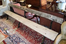A large Victorian cast iron and wood slat garden bench, length 305cm, depth approx. 55cm, height