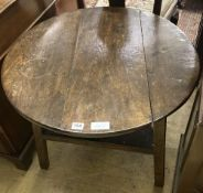 An 18th / 19th century circular oak cricket table, 70cm diameter, height 63cm