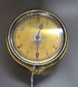 An early 20th century Smith's brass automobile timepiece, diameter 9cm