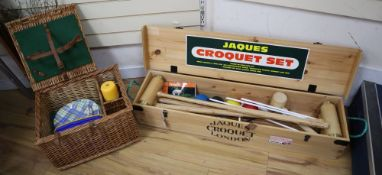 A modern Jacques croquet set, cased and a picnic set in a wicker basket with bottle compartments