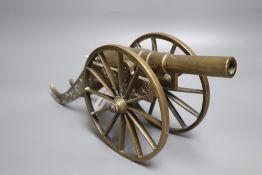 A bronze model canon, length 32cm