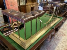 A Victorian style brass club fender with buttoned brown leather seats, length 161cm, depth 49cm,