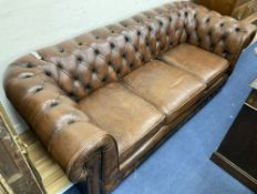 A Victorian style buttoned brown leather three seater Chesterfield settee, width 200cm, depth