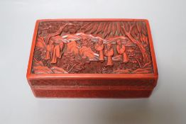 A Chinese cinnabar lacquer box, Qing Dynasty, the cover carved with deity, width 18cm, some