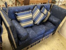 A three seater Knoll settee upholstered in dark blue damask, width 182cm, depth 78cm, height 114cm