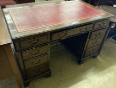 A 1920s mahogany pedestal desk, width 122cm, depth 58cm, height 75cm