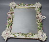 A 19th century Continental cherub and floral encrusted porcelain dressing mirror, height 43cm