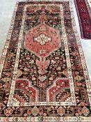 A Hamadan rug 250cm x 130cm