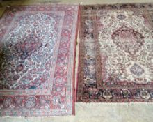 An Isfahan rug (worn) and another rug, largest 216 x 132cm