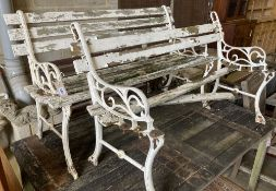 A pair of Victorian style slatted aluminium garden benches (in need of repair), width 122cm