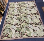 A needlework rug, worked with a water lily design, 264 x 180cm