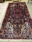 A Hamadan rug 295cm x 142cm