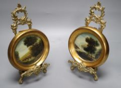 A pair of brass miniature easels and a pair of oils on copper of landscapes, width 15cm