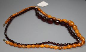 Two faux amber bead necklaces.