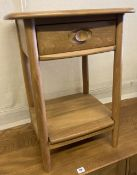 An Ercol light elm two tier occasional table, width 49cm, depth 43cm, height 65cm