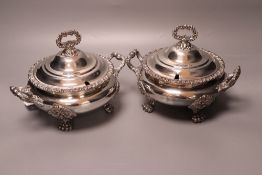 A pair of early 19th century Old Sheffield plate circular two-handled tureens and covers, acanthus-