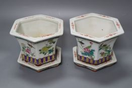 A pair of Chinese famille rose jardinieres and stands, diameter 13cm