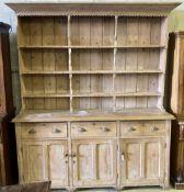 A late Victorian pine dresser, width 200cm depth 54cm height 238cm