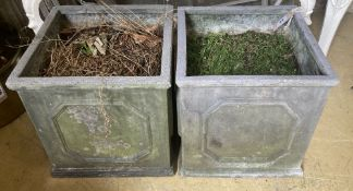 A pair of composition faux lead square garden planters, height 32cm