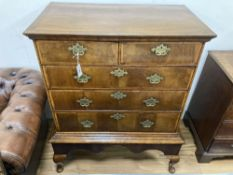 An 18th century cross banded walnut chest on stand, width 98cm, depth 56cm, height 121cm