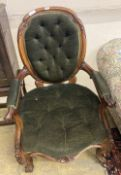 A Victorian carved walnut spoonback armchair, width 62cm, height 94cm