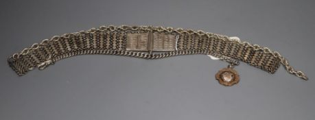 An Indian white metal belt and two alberts including silver and a silver and yellow metal