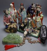 Three Chinese enamelled porcelain figures of immortals, tallest 24cm, three Shiwan type pottery