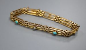A 15ct gold long gate-link bracelet set with turquoise cabochons and seed pearls, gross 12.7g.