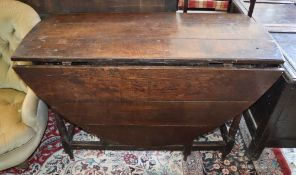 An oak gate leg table, width 116cm, depth 55cm, height 72cm (unextended)