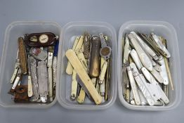 A collection of mother of pearl and silver folding fruit knives, and other sundry pocket knives