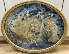 An early 19th century oval embroidered and coloured silk picture of a knight, his lady and son, gilt