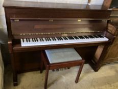 A Kemble upright piano and stool, width 150cm
