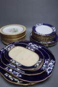 A part-set of eleven Royal Worcester bone china dessert plates, 23.5cm and a Copeland & Garrett bone