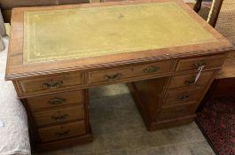 A late Victorian walnut pedestal desk, width 122cm depth 68cm height 76cm