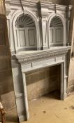 An early 20th century painted pine fire surround with double niche, width 134cm, depth 41cm,