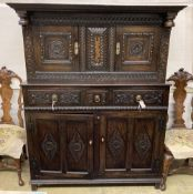 A late 18th century carved oak court cupboard, width 130cm, depth 52cm, height 170cm